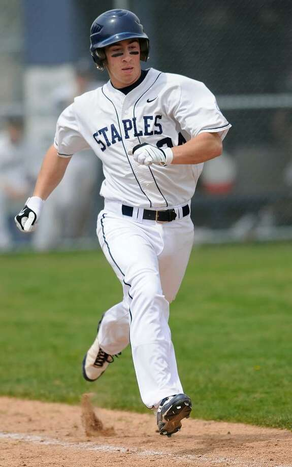 Staples High School hosts Trumbull High School for boys varsity baseball action on Wednesday, April 21, 2010. Staples #24 Tyler Jacobs hustles down the first base line to earn a fifth-inning hit. / Shelley Cryan Photo: Shelley Cryan / 2010 Shelley Cryan