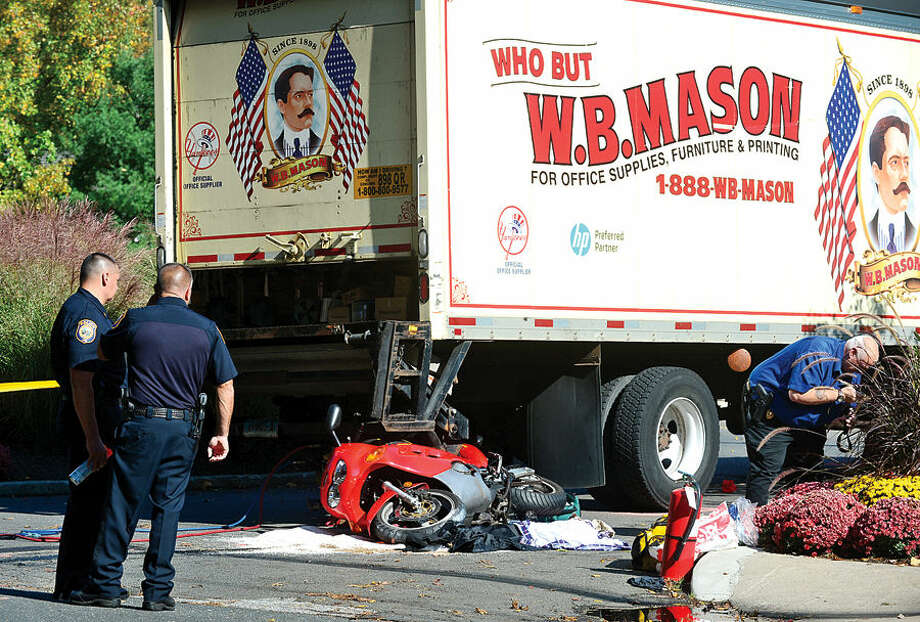 Hour photo / Erik Trautmann Wesrport police investigate a motor vehicle accident that sent a motorcyclist to the hospital and closed Riverside Ave Friday afternoon.