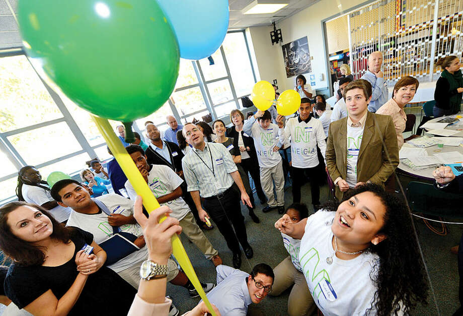 Hour photo / Erik Trautmann Norwalk High School student and mentee Karla Corona, lower right, launches her balloon rocket experiment with the help on IBM employee and mentee, Steve Wysmuller, at bottom, as Norwalk Early College Academy (NECA) and IBM kick-off the school's new mentoring program Friday at Norwalk Communtiy College. NECA is the state's first Pathways in Technology Early College High School (P-TECH). The 9-14 Model School, a collaboration among IBM, Norwalk Public Schools and Norwalk Community College, pairs each student with an IBM mentor, providing students with support and guidance to develop the employability skills needed to succeed in today's workforce. Students who successfully complete the six-year program, which spans grades 9 to 14, graduate with a no-cost Associate in Applied Science degree and will be first in line for available jobs at IBM.