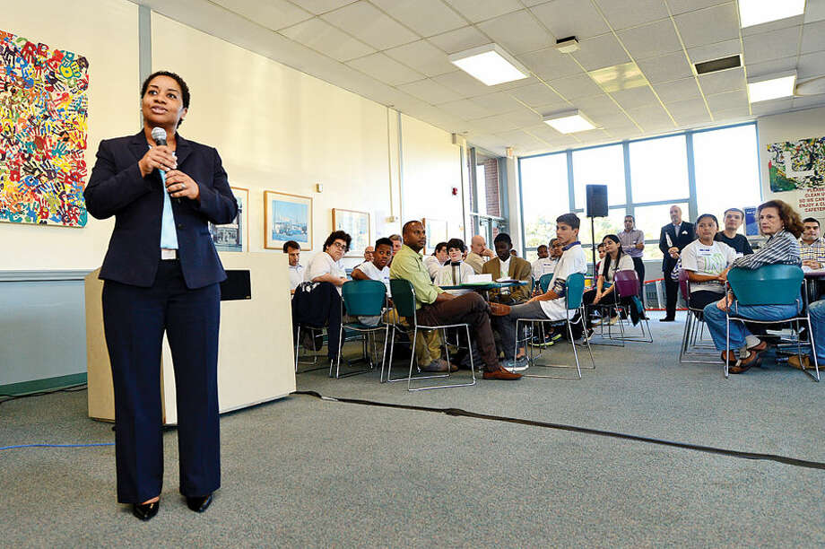 Hour photo / Erik Trautmann Norwalk Early College Academy (NECA) Director Karen Amaker speaks during the NECA and IBM kick-off event for the school's new mentoring program Friday at Norwalk Communtiy College. NECA is the state's first Pathways in Technology Early College High School (P-TECH). The 9-14 Model School, a collaboration among IBM, Norwalk Public Schools and Norwalk Community College, pairs each student with an IBM mentor, providing students with support and guidance to develop the employability skills needed to succeed in today's workforce. Students who successfully complete the six-year program, which spans grades 9 to 14, graduate with a no-cost Associate in Applied Science degree and will be first in line for available jobs at IBM.