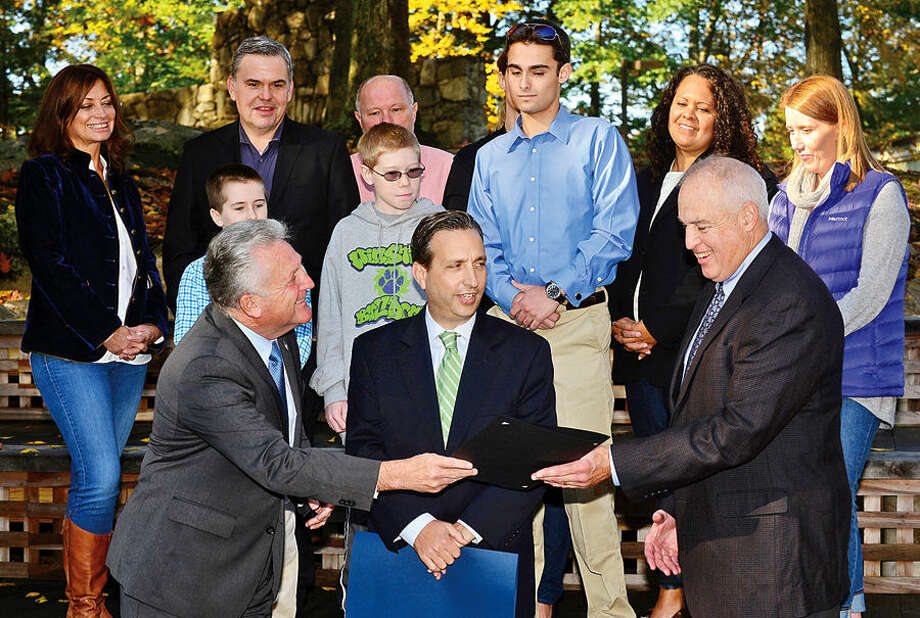 Hour photo / Erik Trautmann Norwalk Mayor Harry Rilling presents M. Jeffrey Spahr, president of the board for the Connecticut Association for Children and Adults with Learning Disabilities, a proclamation as State Senator Bob Duff (D-25), center, looks on during a press conference on ADHDAwareness Month at Winston Prep School Friday morning.