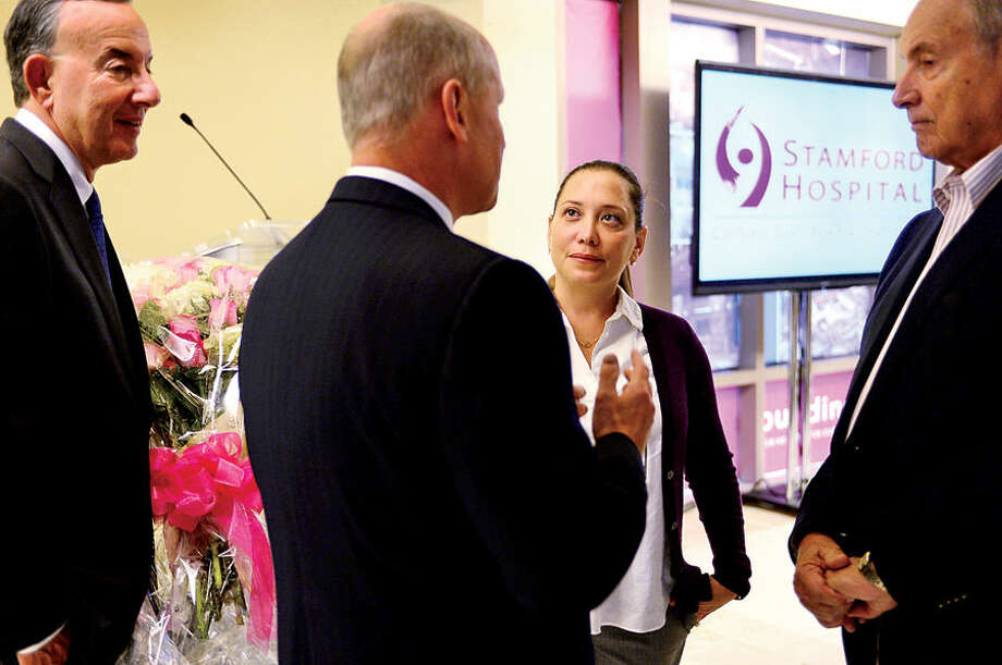 Stamford Hospital CEO and president Brian Grissler, second from left, thanks Alexandra Cohen for a $20 million gift from the Cohen Foundation as cardiologist Ed Schuster, left, and co-chair of the Stamford Hospital Foundation Board of the Directors, George Sarner, look on following a press conference Thursday morning at Stamford Hospital.