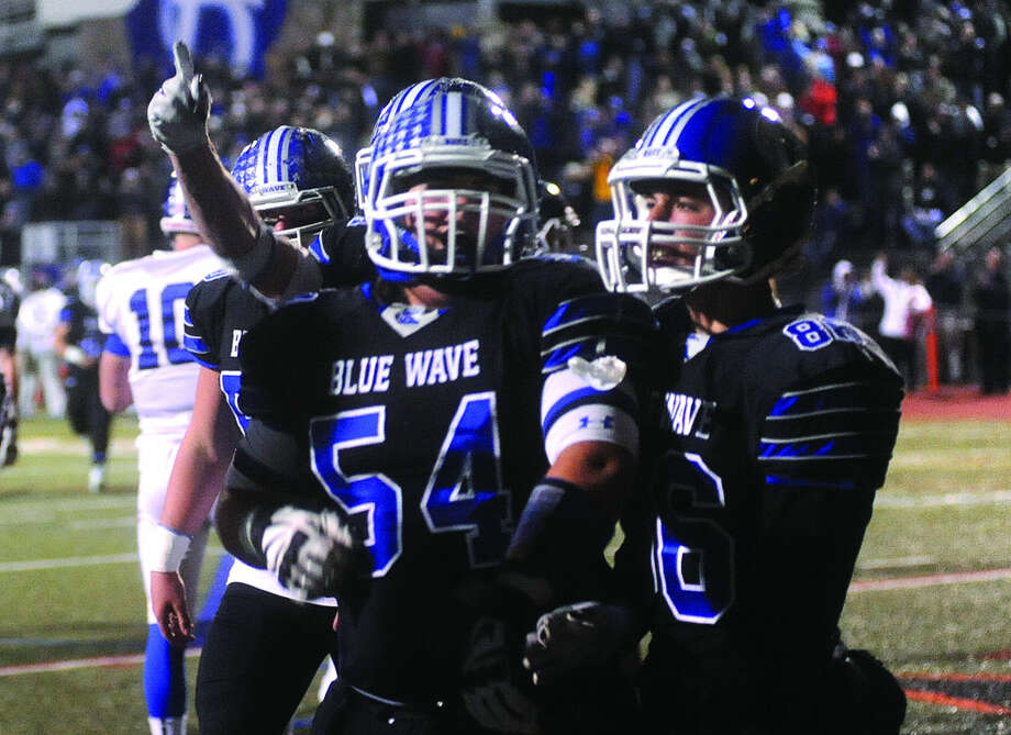 Darien Blue Wave celebrates Monday after scoring. Hour photo/Matthew Vinci