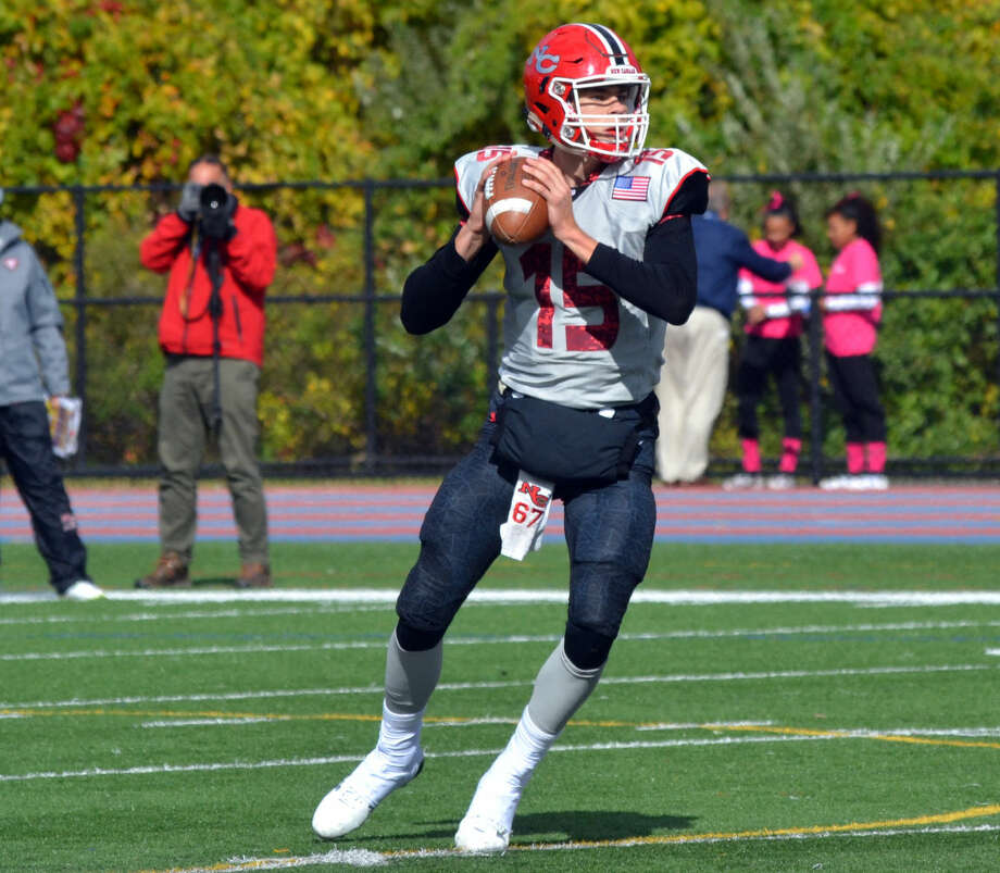 New Canaan's Michael Collins looks to pass against Danbury on October 17, 2015. (Pete Paguaga/Hour photo)
