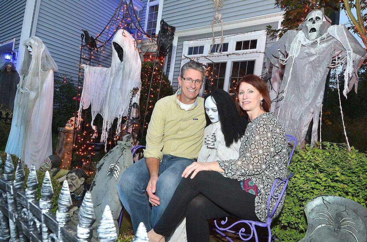 Hour Photo/Alex von Kleydorff Robert and Sandy Timmons have a seat with one of their Halloween guests in front of their Norwalk home
