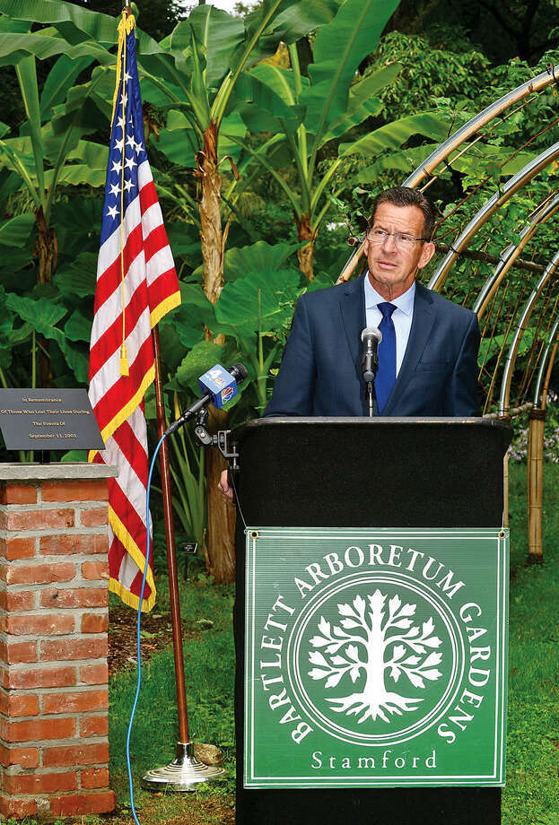 "Hour photo / Erik TrautmannIn this file photo, Governor Dannel P. Malloy attends the dedication ceremony and unveiling of the ""Arch of 9/11 Remembrance"" at the Bartlett Arboretum & Gardens in Stamford Friday. The archway is comprised of 14 living trees that are offspring of the 9/11 Survivor Tree, a Callery pear that was located on the grounds of the World Trade Center during the 2001 attacks."