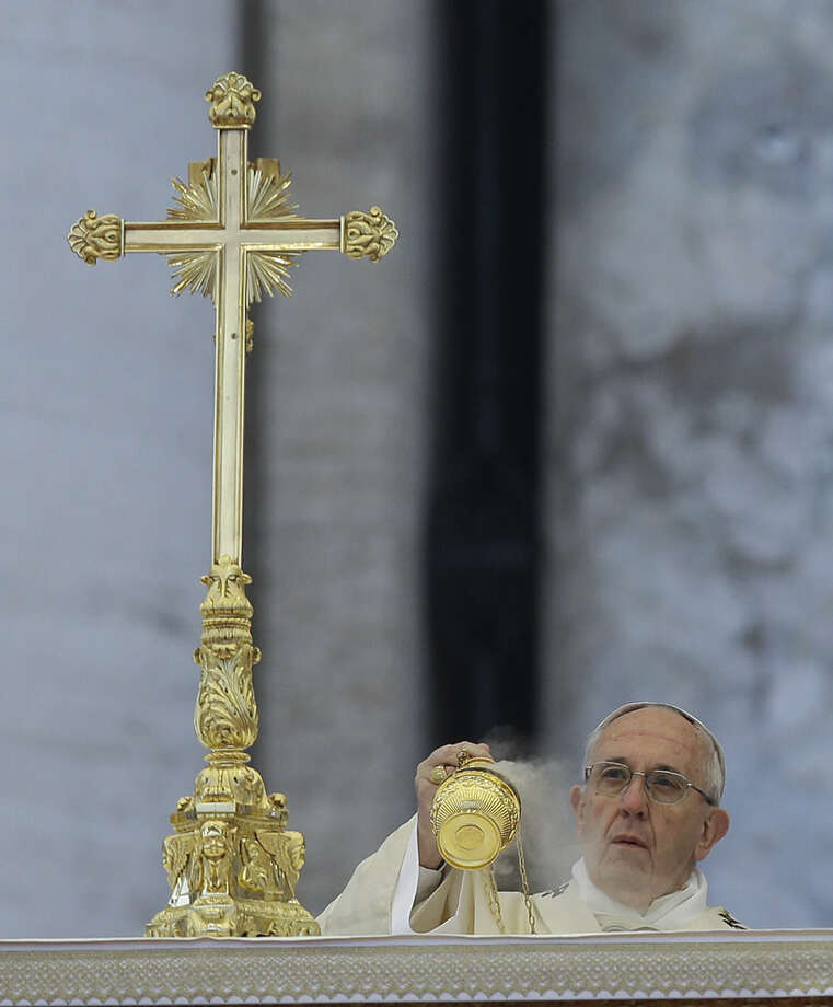 Pope Francis spreads incense during a Mass ahead of the opening of the Holy Door of St. Peter's Basilica, formally starting the Holy Year of Mercy, at the Vatican, Tuesday, Dec. 8, 2015. Francis launched the 12-month jubilee to emphasize what has become the leitmotif of his papacy: to show the merciful and welcoming side of a Catholic Church more often known for its moralizing and judgment. (AP Photo/Gregorio Borgia)