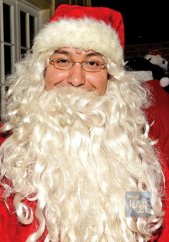 Hour photo / Erik Trautmann Danny Oliveira dresses up like Santa for the 2015 Stamford SantaCon pub crawl Saturday.
