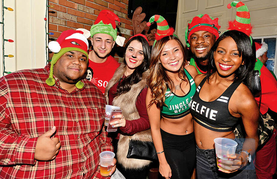 Hour photo / Erik Trautmann Vlad Joseph, Tommy Carlucci, Alyssa Corsano, Joy Vandermark, Dominique Philitas and Ahmed Arnold grab a beer at Brickhouse during the 2015 Stamford SantaCon pub crawl Saturday.
