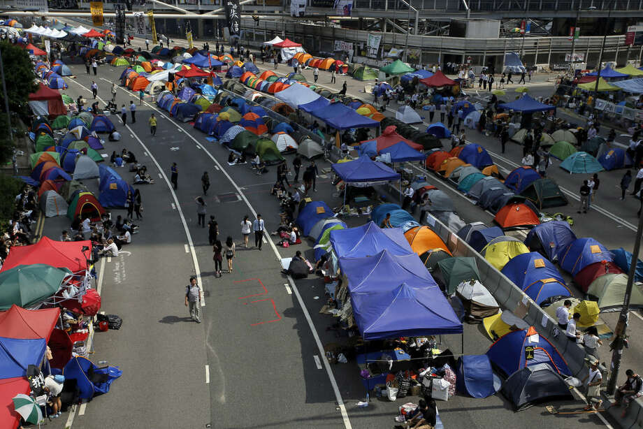Lines of tents set up by pro-democracy protesters are seen in an occupied area near government headquarters in Hong Kong Thursday, Oct. 16, 2014. Hong Kong Chief Executive Leung Chun-ying said Thursday he is ready to start talks as soon as next week with student leaders of the pro-democracy protests that have rocked the city for nearly three weeks. (AP Photo/Vincent Yu)