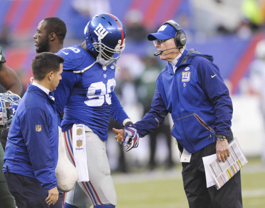 New York Giants defensive end Jason Pierre-Paul (90) leaves the game after being hurt during the second half of an NFL football game against the New York Jets Sunday, Dec. 6, 2015, in East Rutherford, N.J. (AP Photo/Bill Kostroun)