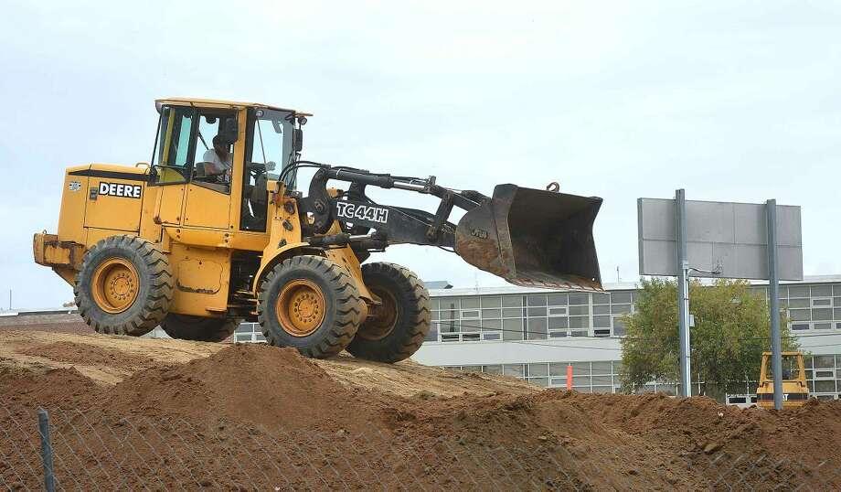 Hour Photo/Alex von Kleydorff Heavy equipment works on the upper field at Nathan hale School on Wednesday
