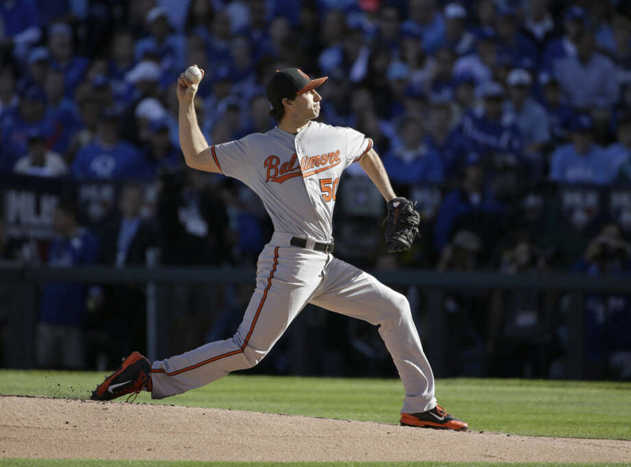 Baltimore Orioles starting pitcher Miguel Gonzalez throws during the first inning of Game 4 of the American League baseball championship series against the Kansas City Royals Wednesday, Oct. 15, 2014, in Kansas City, Mo. (AP Photo/Matt Slocum )