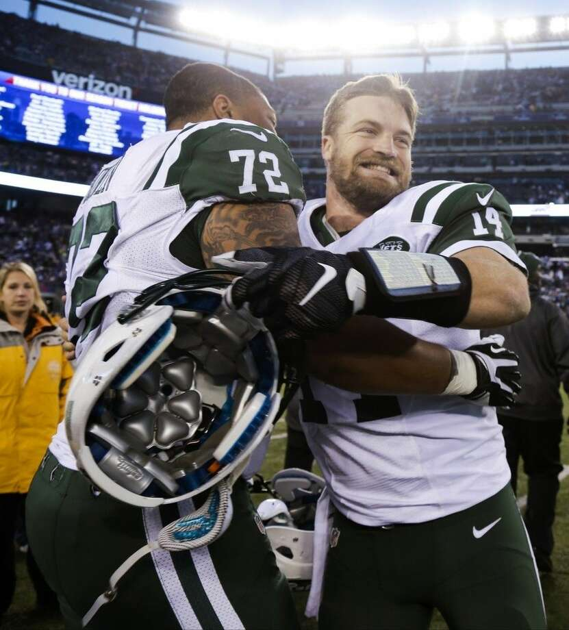 New York Jets quarterback Ryan Fitzpatrick (14) celebrates with Stephen Bowen (72) after overtime of an NFL football game against the New York Giants Sunday, Dec. 6, 2015, in East Rutherford, N.J. The Jets won 23-20. (AP Photo/Julie Jacobson)
