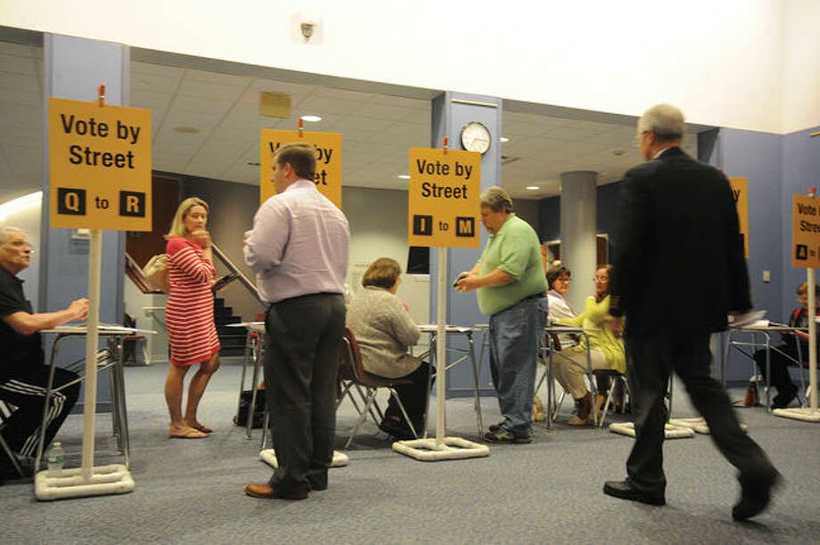 Wilton residents sign in at the Miller-Driscoll renovation project meeting at The Clune Center in Wilton.