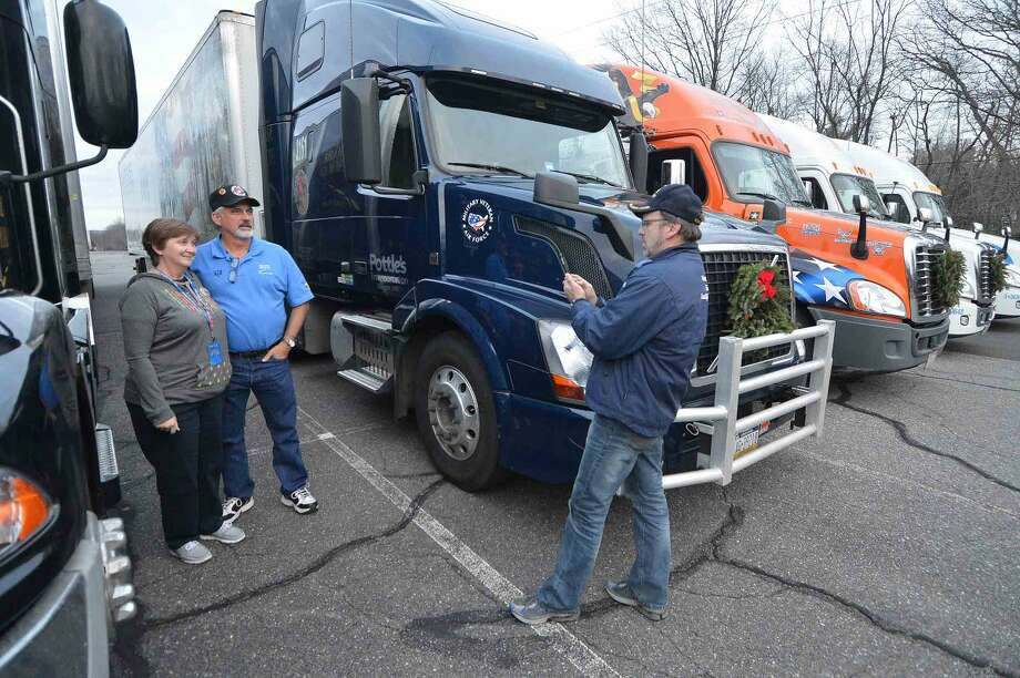 Hour Photo/Alex von Kleydorff Volunteer drivers park their rigs at Norden Park and take a few photos with the Wreaths Across America group that stopped in Norwalk for dinner at The St Ann Club on their way to Arlington National Cemetery.