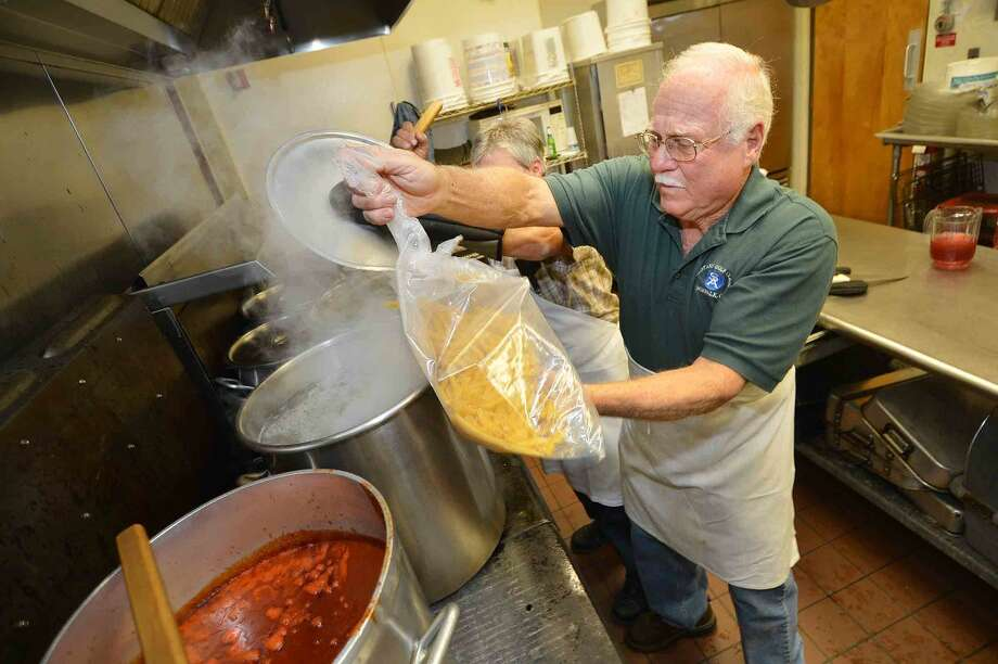 Hour Photo/Alex von Kleydorff Ken Prince gets the ziti into the water, 45 pounds of it to be served to the more than 100 volunteers with the Wreaths Across America group that stopped in Norwalk for dinner at The St Ann Club on their way to Arlington National Cemetery.