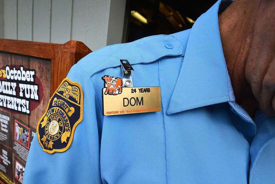 Hour Photo/Alex von Kleydorff Dominic Tropeano Sr. badge with 24 years as security guard he will retire soon