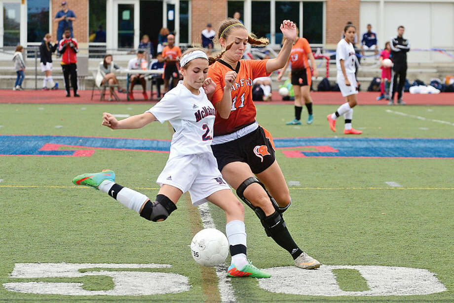 Hour photo / Erik Trautmann Brien McMahon High School Senator # 24 Mikayla Fosina battles Stamford's #11 Mia Vitti during their girls soccer match Saturday in Norwalk.