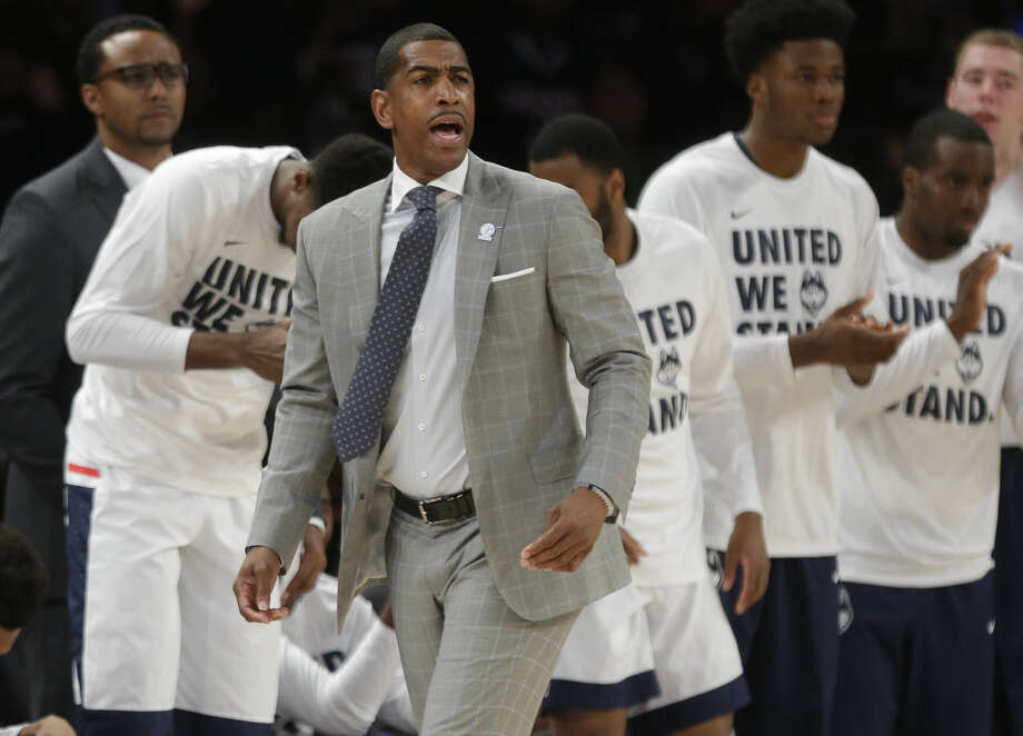 Connecticut head coach Kevin Ollie calls out to his team during the first half of an NCAA college basketball game against Maryland, Tuesday, Dec. 8, 2015, in New York. (AP Photo/Frank Franklin II)