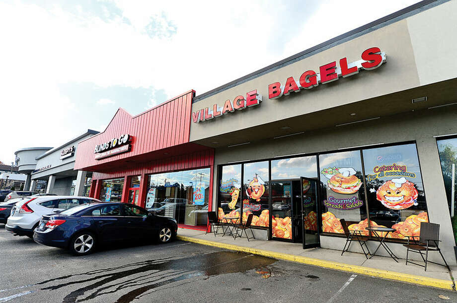 Hour photo / Erik Trautmann An employee of Village Bagels on Westport Ave in Norwalk fought off a burglar Saturday morning who smashed the front door to gain entry to the store.