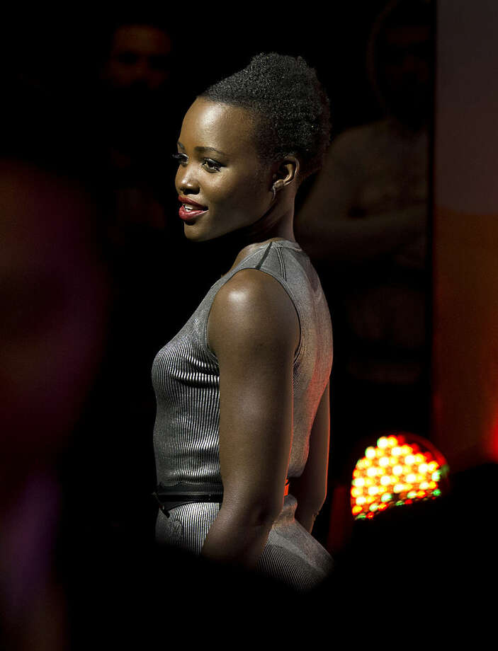 "Kenyan actress Lupita Nyong'o, who was born in Mexico, walks past waiting fans, at a fan event to promote ""Star Wars: The Force Awakens,"" at Antara Fashion Mall in Mexico City, Tuesday, Dec. 8, 2015. The newest installment of Star Wars opens in some markets on Dec. 16, and will open in Mexico on Dec. 17. (AP Photo/Rebecca Blackwell)"