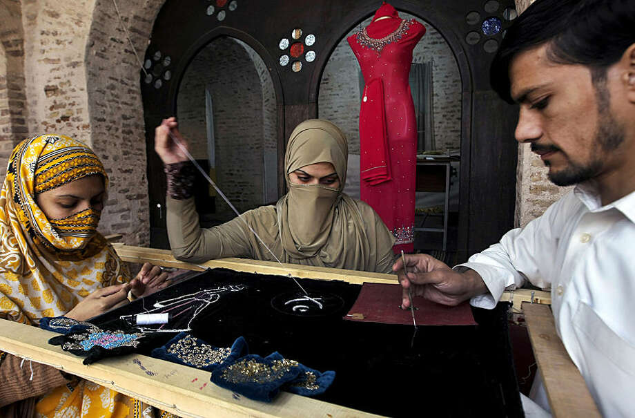 Pakistani women learn traditional embroidery on costumes at a governmental training center in Peshawar, Pakistan, Tuesday, Dec. 8, 2015. (AP Photo/Mohammad Sajjad)