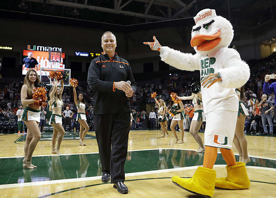 Miami football coach Mark Richt is introduced to fans during an NCAA college basketball game between Miami and Florida, Tuesday, Dec. 8, 2015, in Coral Gables, Fla. Miami won 66-55. (AP Photo/Alan Diaz)