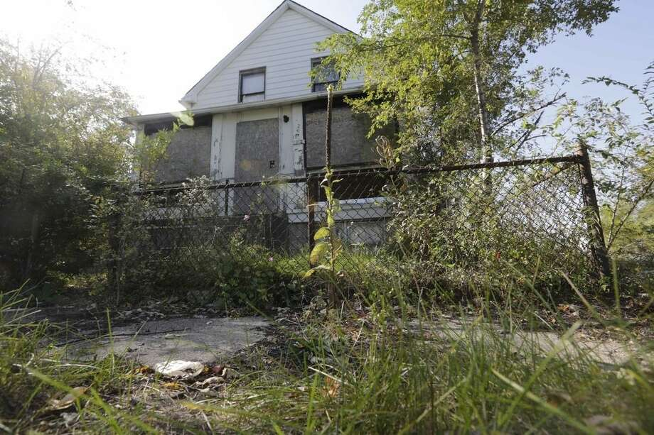 This Monday, Oct. 20, 2015, shows an abandoned home at 2200 Massachusetts in Gary, Ind., where police found the one of six women's bodies over the weekend. Police investigating the slayings of seven women whose bodies were found in northwestern Indiana say the suspect has told them that he may have killed people going back 20 years. The Lake County prosecutor's office on Monday charged 43-year-old Darren Vann in the strangulation death of 19-year-old Afrikka Hardy. Police say her body was found Friday night at a Motel 6 in Hammond. Police say Vann provided information that led authorities to the bodies of the six other women in the nearby city of Gary, Indiana. (AP Photo/M. Spencer Green)