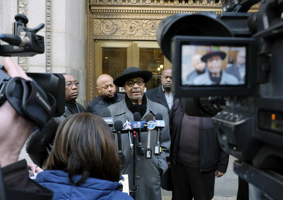 Bishop Larry Trotter, the senior pastor of Sweet Holy Spirit Church, speaks at a news conference Wednesday, Dec. 9, 2015, outside Chicago's City Hall before a special City Council meeting where Mayor Rahm Emanuel is to give an address about Chicago's police department. At least four different groups are planning protests throughout the day in and around City Hall to draw attention to cases of alleged abuse by police officers. At least one group says it is demanding Mayor Rahm Emanuel's resignation. (AP Photo/Kiichiro Sato)