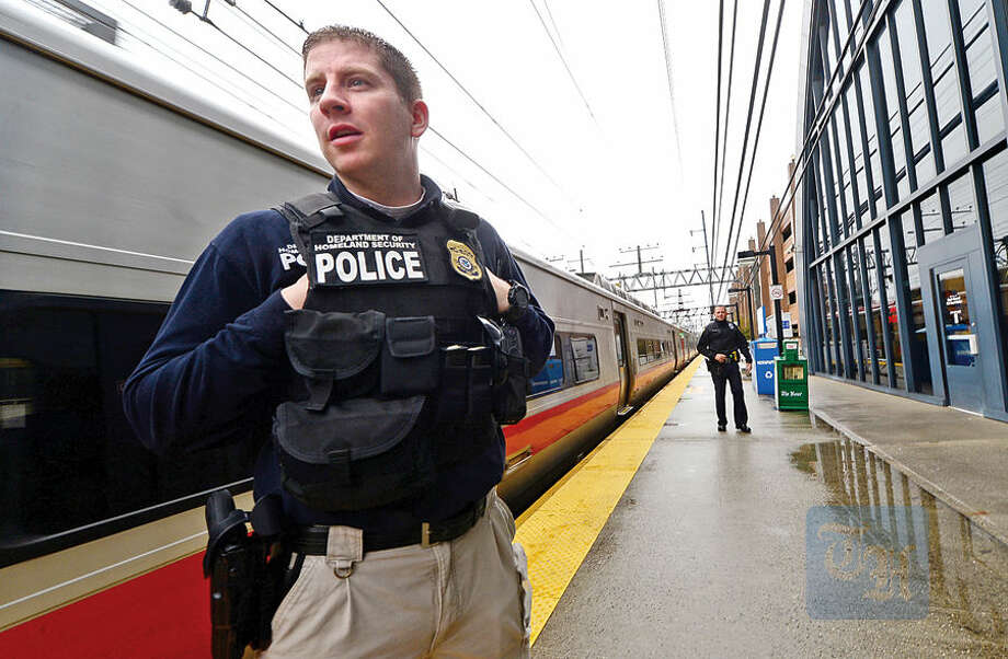 Hour photo / Erik Trautmann Department of Homeland Security agents, the TSA, MTA and Norwalk police take part in a routine patrol at the South Norwalk Train Station Wednesday morning.