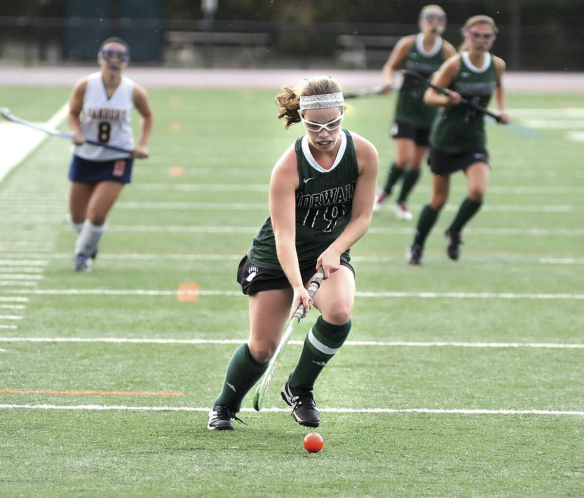 Hour photo/John Nash Norwalk High School senior Allison Hall, front, pushes the ball up the field during Tuesday's game at Danbury High School. Hall is one of three senior captains for the Bears, who are on the cusp of their first FCIAC tournament appearance in three seasons.