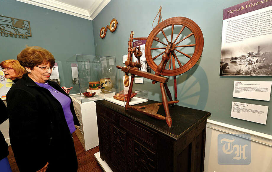 Hour photo / Erik Trautmann Wilton resident Carol Salvato visits the new Norwalk Museum during it's Ribbon Cutting & Holiday Open House Saturday.