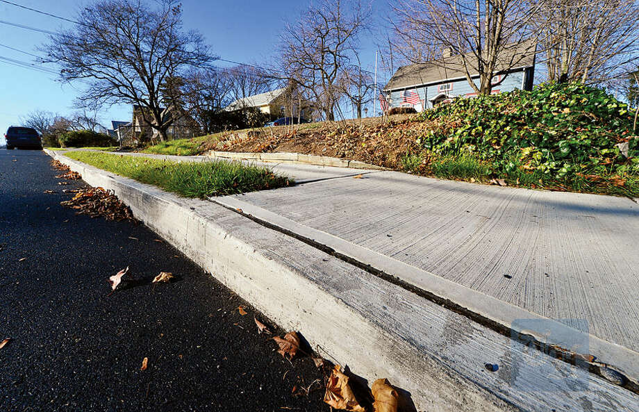 Hour photo / Erik Trautmann The Norwalk Public Works Committee will seek input from the law department before acting on an elderly resident's request for reimbursement of sidewalk replacement after city repaved Eversley Ave and installed new sidewalks free of charge to other residents.