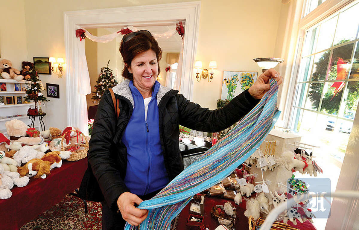 Hour photo / Erik Trautmann Norwalk resident Joyce Generoso shops at St. Paul's on the Green Holiday Market Friday which runs through Sunday, with hours 10-5 Saturday and 12-5pm Sunday.