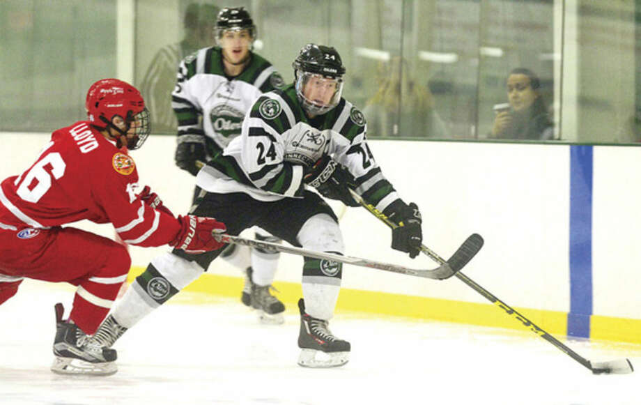 Hour photo/Erik TrautmannCT Oilers' Alex Wlkinson skates past New York Applecores' Brendan Lloyd on Thursday.
