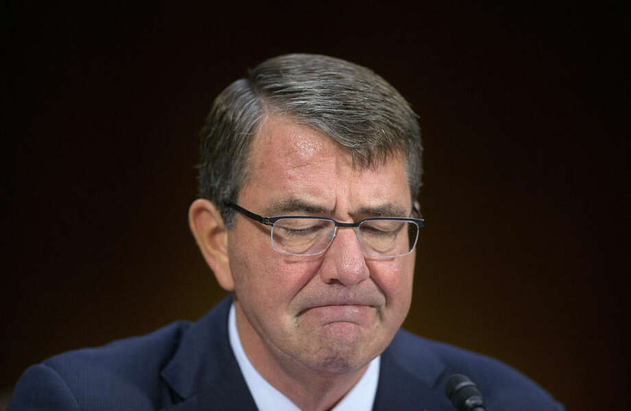 Defense Ash Carter pauses as he testifies on Capitol Hill in Washington, Wednesday, Dec. 9, 2015, before the Senate Armed Service Committee on the Islamic State. Carter said the U.S. is prepared to assist the Iraqi army with more personnel and equipment to help them fight Islamic State militants. (AP Photo/Pablo Martinez Monsivais)