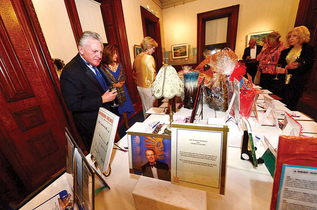 Hour photo / Erik Trautmann Norwalk mayor Harry Rilling looks over the silent auction items during the Lockwood Mathews Mansion Museum Gala, Mystery at Elm Park: The Mansion's Pen and Inkwell Gala Saturday.