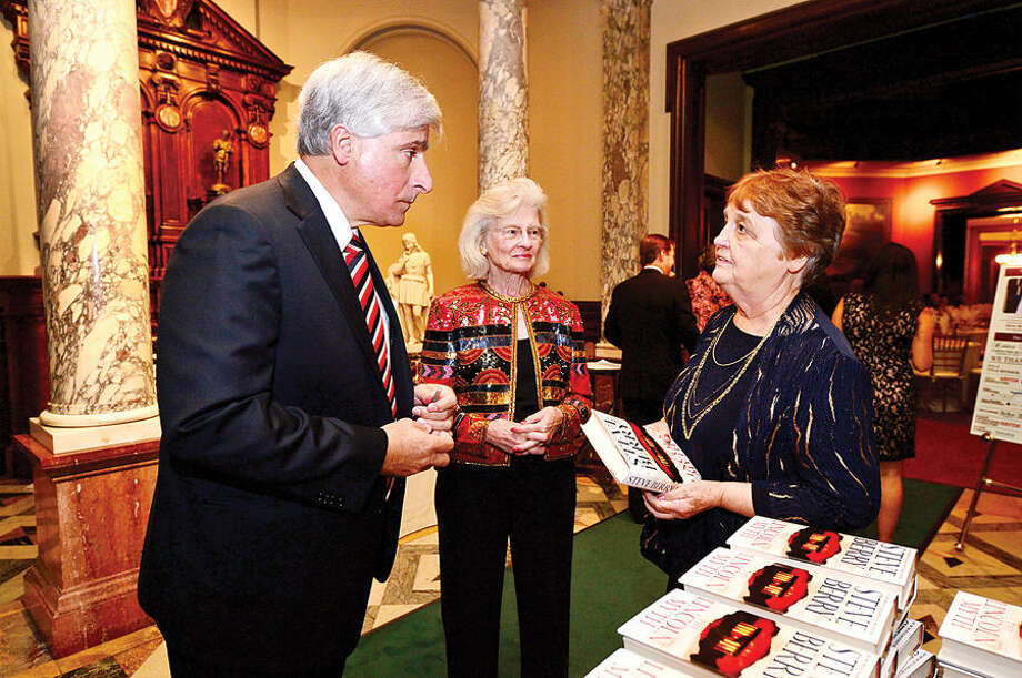 Hour photo / Erik Trautmann Author Steve Berry chats trustee Mimi Findlay and board chair Patsy Brescia with during the Lockwood Mathews Mansion Museum Gala, Mystery at Elm Park: The Mansion's Pen and Inkwell Gala Saturday.