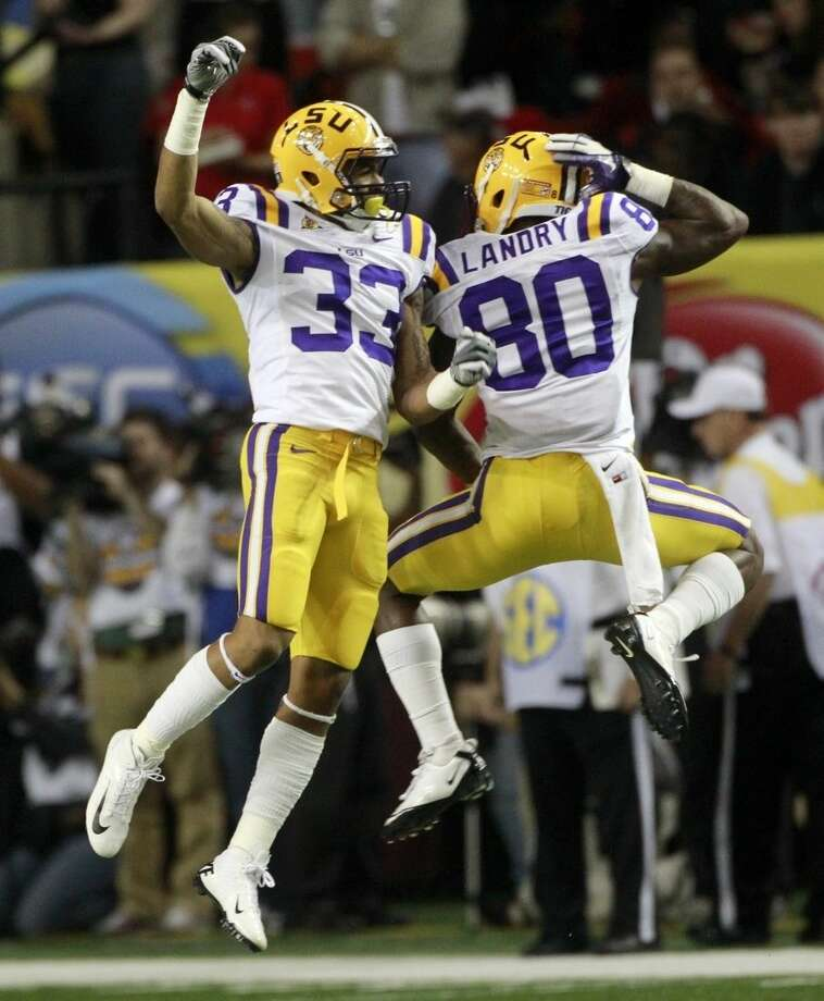 FILE - In this Dec. 3, 2011, file photo, LSU wide receiver Odell Beckham (33) and Jarvis Landry(80) react to an LSU touchdown during the second half of the Southeastern Conference championship NCAA college football game against Georgia, in Atlanta. Former LSU teammates Odell Beckham Jr. and Jarvis Landry are two of the NFL's best young receivers, and they'll play each other for the first time Monday, Dec. 14, 2015, when the Giants visit the Dolphins.. (AP Photo/John Bazemore)