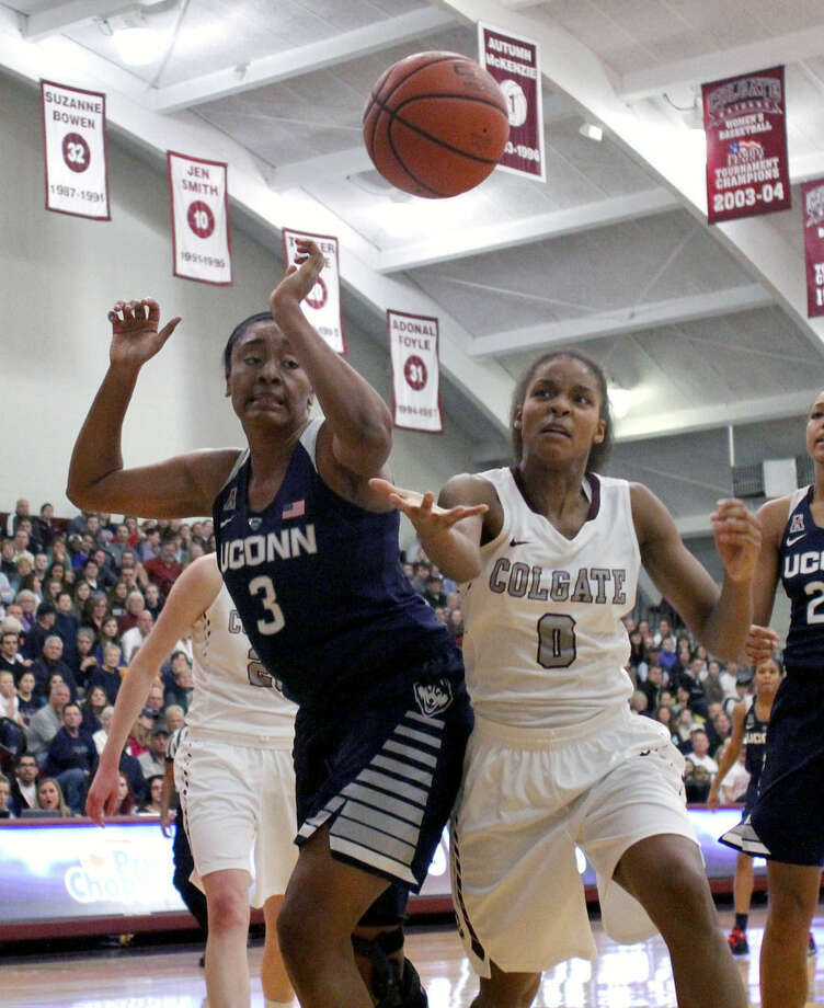 Connecticut's Morgan Tuck, left, and Colgate's Mylah Chandler, right, battle for a loose ball in the first quarter of an NCAA college basketball game in Hamilton, N.Y., Wednesday, Dec. 9, 2015. (AP Photo/Nick Lisi)