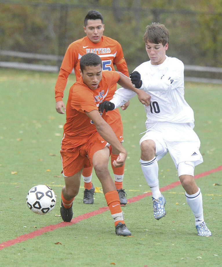 Hour Photo/Alex von KleydorffWilton's Jack Brandt, right, tries to take the ball from a Danbury player during Wednesday's game at Fujitani Field in Wilton.