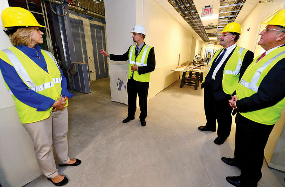 Hour photo / Erik Trautmann Norwalk Hospital Vice President of Operations, James Haynes, second from left, leads elected officials on a tour of the new Anne P. and Harold W. McGraw, Jr., Center, a five-story, 95,500-square-foot addition, slated for completion in 2015.