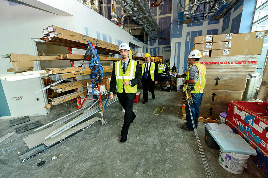 Hour photo / Erik Trautmann Norwalk Hospital Vice President of Operations, James Haynes, leads local officials on a tour of the new Anne P. and Harold W. McGraw, Jr., Center, a five-story, 95,500-square-foot addition, slated for completion in 2015.