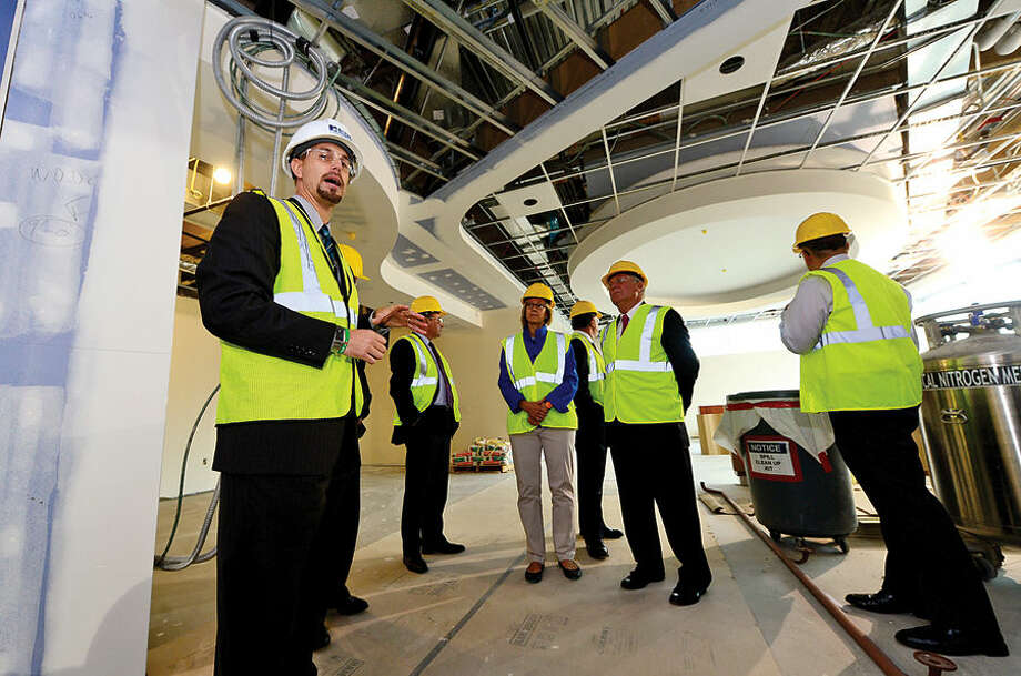 Hour photo / Erik Trautmann Norwalk Hospital Vice President of Operations, James Haynes, left, leads local officials on a tour of the Digestive Diseases floor in the new Anne P. and Harold W. McGraw, Jr., Center, a five-story, 95,500-square-foot addition, slated for completion in 2015.