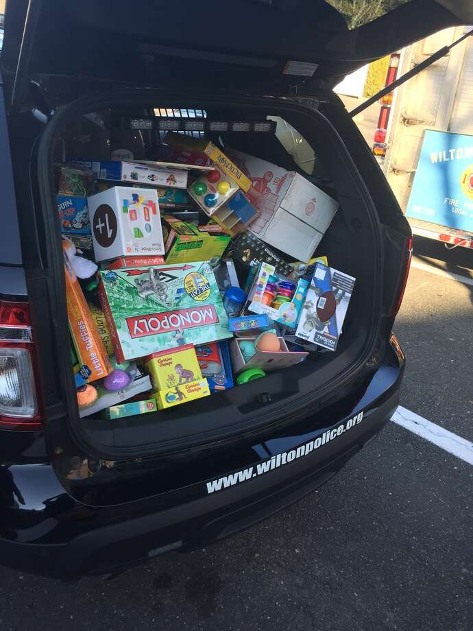 "The Wilton police and fire departments teamed up with the Toy Chest to take the Toys for Tots collection drive to another level this year. The ""Stuff a Cruiser"" event was held Sunday at 21 River Road in the Stop and Shop plaza."