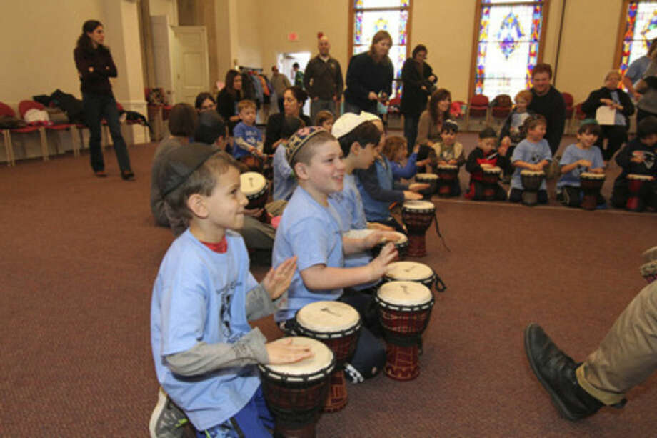 Contributed photoNavasky Explorers (religious school) in Norwalk ushered in the Hanukkah seasonwith an event called the Hanukkah Bash. In addition to activity centers, our youngsters had the opportunityto re-create the Hanukkah story on drums with a group called Jewish Drum Tales.
