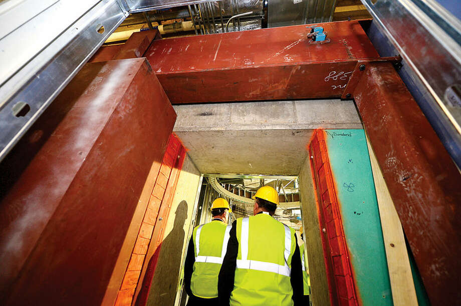 Hour photo / Erik Trautmann Norwalk Hospital takes local officials on a tour of the linear accelerator room incased within 4 foot thick concrete walls in the new Anne P. and Harold W. McGraw, Jr., Center, a five-story, 95,500-square-foot addition, slated for completion in 2015.