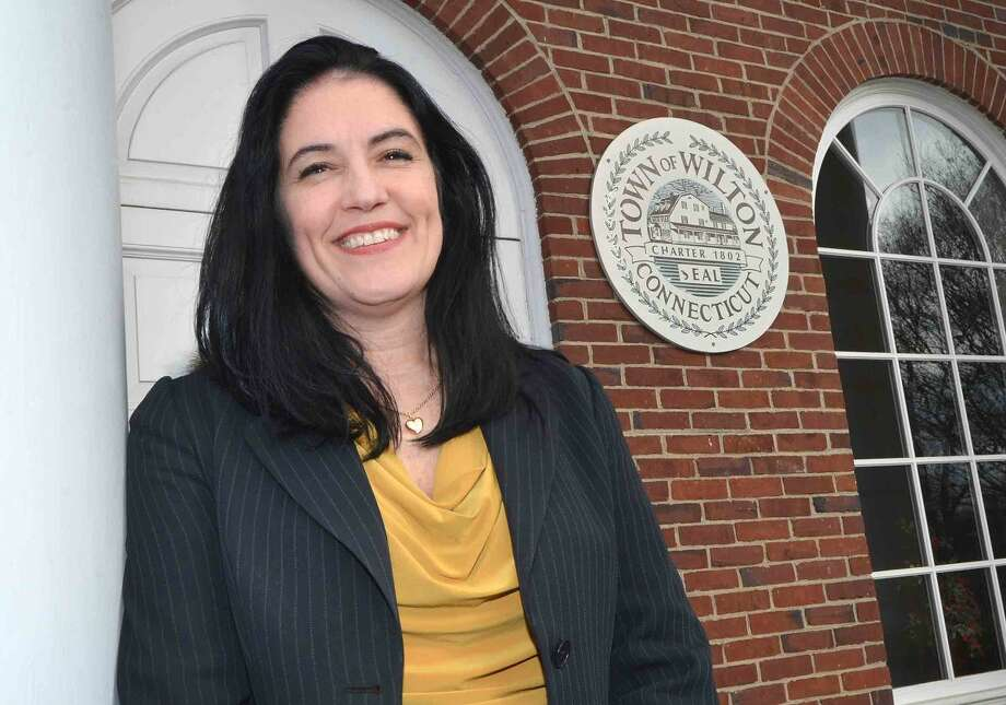 Wilton's new CFOAnne Kelly-Lenz stands at the doorstep of Town Hall.