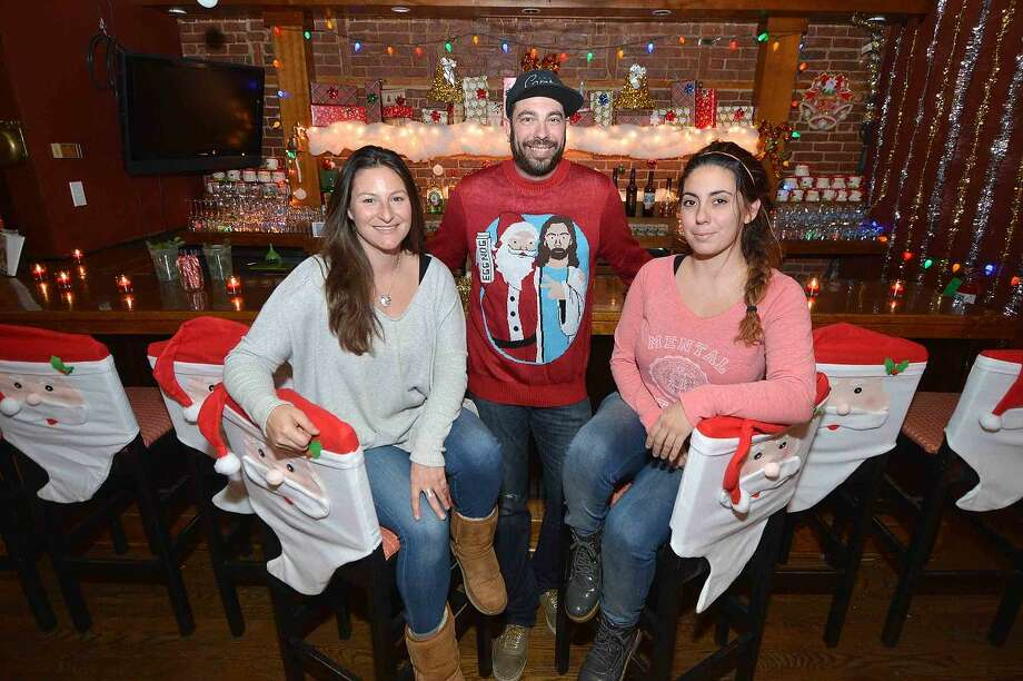 """Hour Photo/Alex von Kleydorff Owner of """" The Miracle on Wall Street """" Pop up bar Jihn Mcnulty with Lindsay Bartlett and Raffa Dowling inside the Christmas Themed bar"""